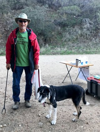 Dr. John Greenwod and his dog hiked the trail and picked up trash.
