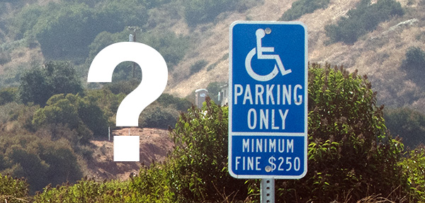 Question mark with a disable persons parking sign